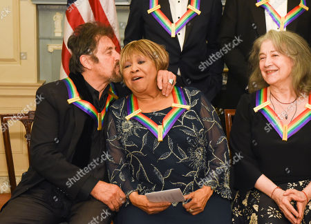 Al Pacino, Mavis Staples, Martha Argerich Kennedy Center Honorees Al Pacino kisses fellow honoree Mavis Staples, center, with honoree Martha Argerich, right, following the State Department for the Kennedy Center Honors gala dinner, in Washington