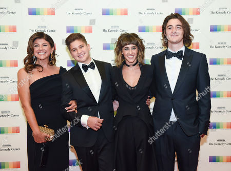 Stock Image of Cindy Frey, Otis Frey, Taylor Frey, Deacon Frey The family of Eagles band member Glenn Frey, from left, wife Cindy Frey, Otis Frey, Taylor Frey, and Deacon Frey arrive at the State Department for the Kennedy Center Honors gala dinner on in Washington
