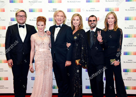 Christian Quilici, Lucy Walsh, Joe Walsh, Marjorie Bach, Ringo Starr, Barbara Bach Kennedy Center Honoree Joe Walsh, third from left, of the Eagles arrives with from left, Christian Quilici, Lucy Walsh, Marjorie Bach, Ringo Starr and Barbara Bach at the State Department for the Kennedy Center Honors gala dinner, in Washington