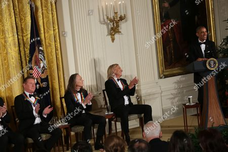 Us President Barack Obama jokes with the band members of the group Eagles (L-R) Don Henley, Timothy B. Schmit, Joe Walsh, 2016 Kennedy Center Honorees