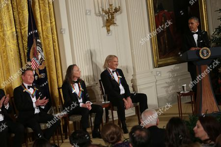 United States President Barack Obama jokes with the band members of the group Eagles (L-R) Don Henley, Timothy B. Schmit, Joe Walsh, 2016 Kennedy Center Honorees