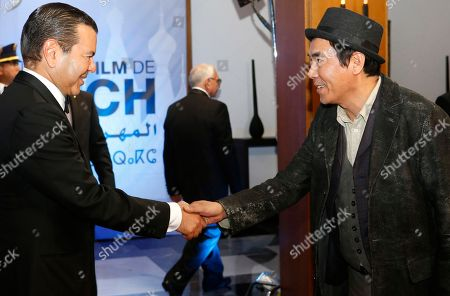 Morocco's Prince Moulay Rachid, left, welcomes South Korean Director Kim Jee-woon before the royal dinner during the 16th Marrakech International Film Festival in Marrakech, Morocco, . The festival runs from Dec. 2-10