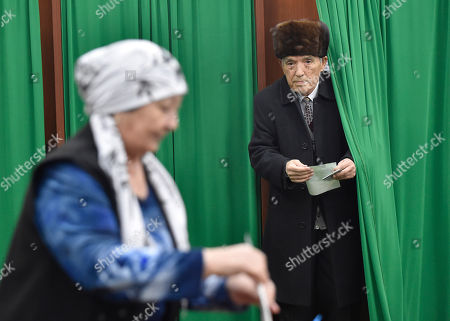 Voters cast their ballots in Uzbekistan's tightly controlled presidential election, the first vote since the death of authoritarian leader Islam Karimov who ruled the country for 27 years, in Tashkent, Uzbekistan, . The odds-on favorite is acting President Shavkat Mirziyoyev, who spent 13 years as Karimov's prime minister