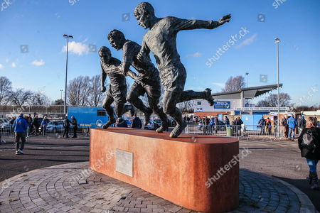 Stock Photo of Stadium shot with statue dedicated to Geoff Hurst, Jimmy Armfield and Simone Perrotta during the The FA Cup match between Curzon Ashton and AFC Wimbledon at Tameside Stadium, Ashton Under Lyne