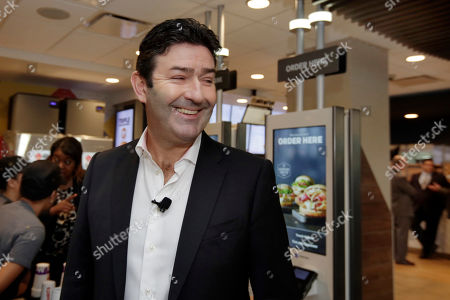 McDonald's CEO Steve Easterbrook prepares to speak during a presentation at a McDonald's restaurant in New York's Tribeca neighborhood. Artisan burger buns, cage-free eggs and table service are some of the changes McDonald's is promising in the U.S. as it scrambles to update its image and win back customers