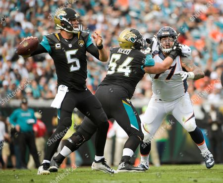Blake Bortles, Christopher Reed, Billy Winn Jacksonville Jaguars guard Christopher Reed (64) blocks Denver Broncos defensive end Billy Winn (97) as quarterback Blake Bortles (5) looks for a receiver during the first half of an NFL football game in Jacksonville, Fla