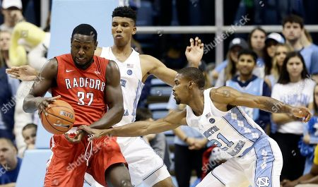 Seventh Woods, Tony Bradley, Randy Phillips North Carolina's Tony Bradley, rear, and Seventh Woods (21) guard Radford's Randy Phillips (32) during the first half of an NCAA college basketball game in Chapel Hill, N.C