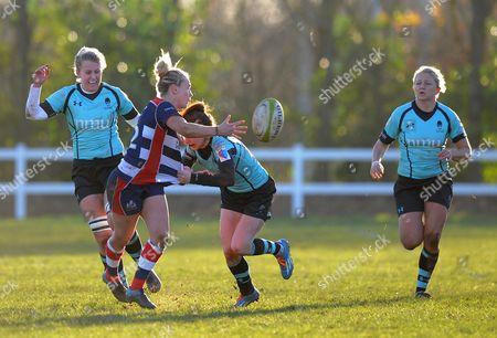 Meg Jones of Bristol Ladies off loads the ball