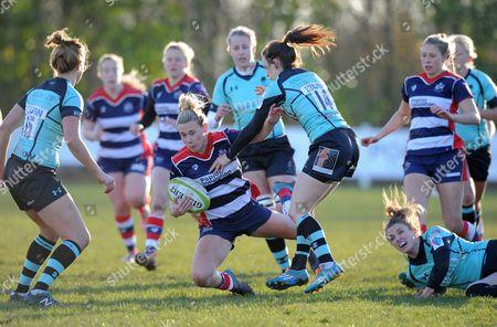 Meg Jones of Bristol Ladies is tackled by Alexia Mavroudis of Worcester Valkyries