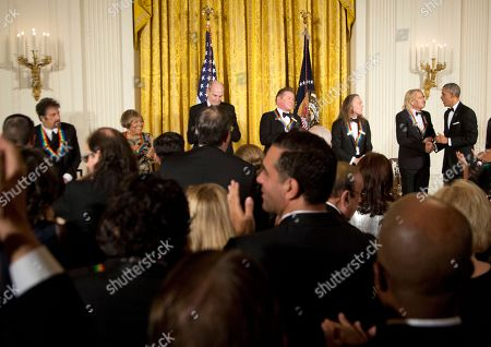 Barack Obama, Al Pacino, Mavis Staples, Martha Argerich, James Taylor, Joe Walsh, Don Henley, Timothy Schmit President Barack Obama, right, congratulates the recipients of the 2016 Kennedy Center Honors, from left, Argentine pianist Martha Argerich, actor Al Pacino, gospel and blues singer Mavis Staples, musician James Taylor, and members of the rock band the Eagles, Don Henley, Timothy Schmit, and Joe Walsh, during a reception in their honor in the East Room of the White House in Washington, hosted by the president and first lady Michelle Obama