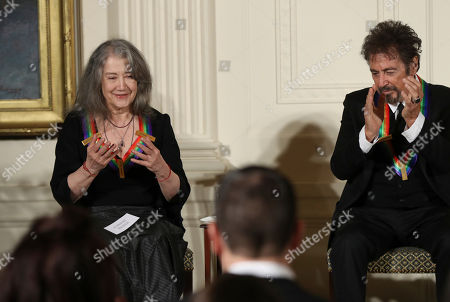 Al Pacino, Martha Argerich The recipients of the 2016 Kennedy Center Honors, Argentine pianist Martha Argerich, left, with actor Al Pacino, makes a gesture as she is recognized during a reception in their honor in the East Room of the White House in Washington, hosted by President Barack Obama and first lady Michelle Obama