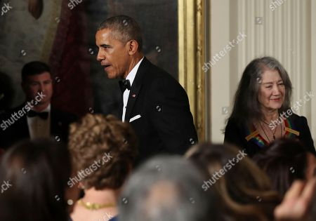 Barack Obama, Martha Argerich President Barack Obama greets the invited guests while 2016 Kennedy Center Honors recipient Argentine pianist Martha Argerich, right, is seated during a reception in their honor in the East Room of the White House in Washington, hosted by the president and first lady Michelle Obama