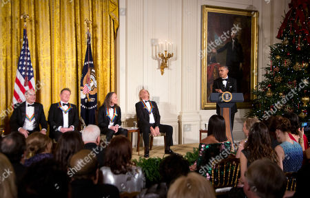 Barack Obama, James Taylor, Joe Walsh, Don Henley, Timothy Schmit President Barack Obama, right, speaks to recipients of the 2016 Kennedy Center Honors, from left, musician James Taylor, and members of the rock band the Eagles, Don Henley, Timothy Schmit, and Joe Walsh and invited quests during a reception in the East Room of the White House in Washington