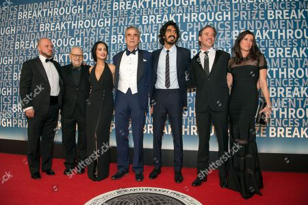 Breakthrough Prize, Devika Boise, Jeremy Irons, Dev Patel, Matthew Brown, The Man Who Knew Infinity The Man Who Knew Infinity's Ed Pressman, Devika Boise, Jeremy Irons, Dev Patel, director Matthew Brown and his wife arrive at the fifth annual Breakthrough Prize Ceremony on at the NASA Ames Research Center in Mountain View, Calif
