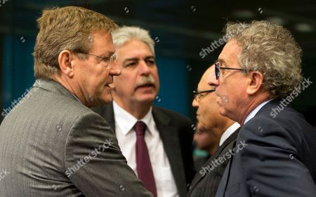 Belgium's Finance Minister Johan Van Overtveldt, left, speaks with Austrian Finance Minister Hans Joerg Schelling, center, and Luxembourg's Finance Minister Pierre Gramegna, right, during a round table meeting of eurozone finance ministers at the EU Council building in Brussels on . Eurozone finance ministers meet on Monday to assess the 19-member currency bloc's budgetary outlook for next year and Greece's progress on economic reforms