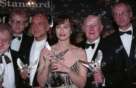 Evening Standard Film Awards at the Savoy Kristin Scott Thomas (winner of Best Actress For 'Four Weddings and A Funeral') and Richard Curtis (winner of Best Screenplay For 'Four Weddings and A Funeral') and Ben Kingsley (winner of Best Actor For 'Schindler's List') and Sir Alec Guinness (winner of the Special Award) and Dave Borthwick (winner of Best Technical Achievement For 'The Secrets of Tom Thumb')