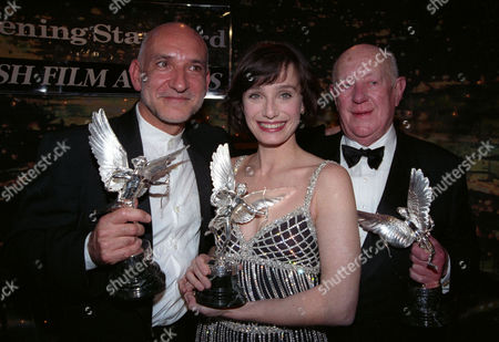 Evening Standard Film Awards at the Savoy Kristin Scott Thomas (winner of Best Actress For 'Four Weddings and A Funeral') and Ben Kingsley (winner of Best Actor For 'Schindler's List') and Sir Alec Guinness (winner of the Special Award)