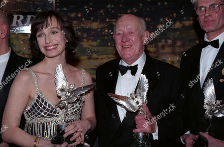 Evening Standard Film Awards at the Savoy Kristin Scott Thomas (winner of Best Actress For 'Four Weddings and A Funeral') and Sir Alec Guinness (winner of the Special Award)
