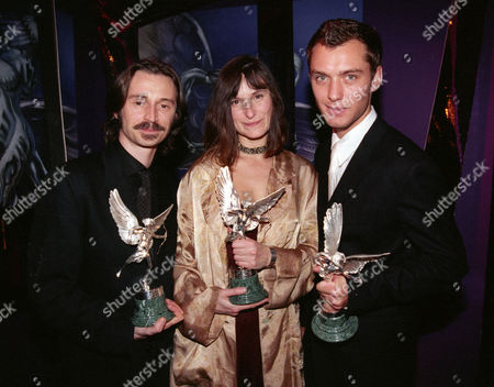 Stock Image of Evening Standard Film Awards at the Savoy Robert Carlyle with Award For 'Best Actor' - 'The Full Monty' 'Carla's Song' and 'Face' Katrin Cartlidge with Award For 'Best Actress' Jude Law with His Award For 'Most Promising Newcomer' - 'Wilde'
