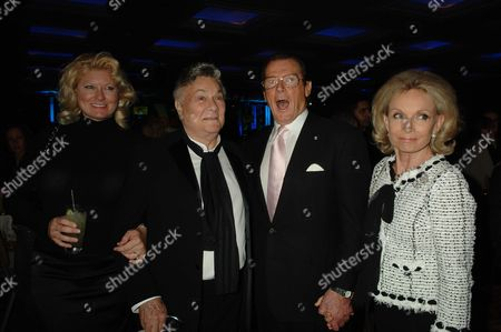 Sony Ericsson Empire Awards at the Hilton London Metropole Tony Curtis with His Wife Jill Vandenberg Curtis and Roger Moore with His Wife Kiki Tholstrup