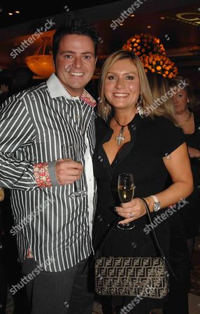Stock Photo of Opening Party of the Gilt Champagne Lounge at the Jumreriah Carlton Tower Hotel Knightsbridge Tricia Penrose with Her Husband Mark Simpkin