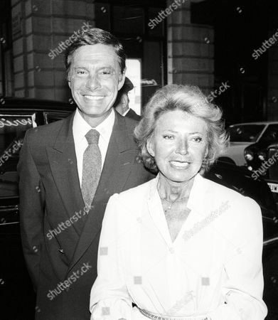 Stock Picture of 4th July Independence Day Party at Langans Brasserie Mayfair Louis Jourdan with His Wife Frederique