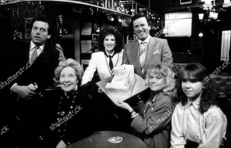 Photocall to Celebrate the 1st Anniversary of Eastenders (l-r) Leslie Grantham Anna Wing Anita Dobson Terry Wogan Wendy Richards and Susan Tully with A Birthday Cake