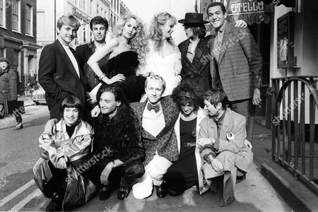 Photocall to Promote Fashion Aid Outside the Groucho Club (back Row L-r )david Emanuel Rifat Ozbek Jerry Hall ? Katharine Hamnett Bruce Oldfield (front Row L-r) Wendy Dagworthy ? Jasper Conran Elizabeth Emanuel ?