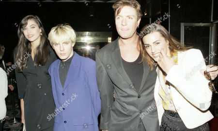 Premiere of 'Dick Tracy' at the Odeon Leicester Square Nick Rhodes with His Wife Julie-anne Friedman and Simon Le Bon with His Wife Yasmin
