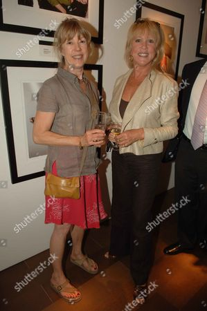 Private View of David Montgomery- 'Shutterbug' at Scream Gallery Bruton Street Patti Boyd (r) with Her Sister Jenny Boyd