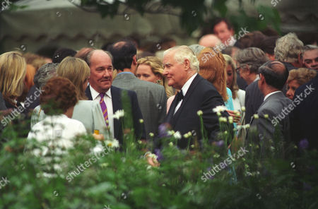 Annual Garden Party in Carlyle Square Ian Wooldridge and Lord Rothermere