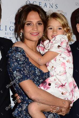 London, England 19th October 2016: Alicia Vikander and Florence Clery at 'the Light Between Oceans' UK Premiere at the Curzon Mayfair in London, England On the 19th October 2016.