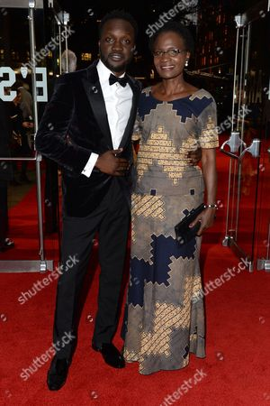 London, England 5th October 2016: Arnold Oceng with His Mum at the Premiere of 'A United Kingdom', at the Opening Night Gala of the 60th Bfi London Film Festival,at the Odeon Leicester Square in London, England On the 5th October 2016.