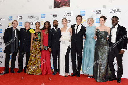 London, England 5th October 2016: Tom Felton, Rick Mccallum, Terry Pheto, Amma Asante, David Oyelowo, Rosamund Pike, Jack Davenport, Laura Carmichael, Jessica Oyelowo and Arnold Oceng at the Premiere of 'A United Kingdom', at the Opening Night Gala of the 60th Bfi London Film Festival,at the Odeon Leicester Square in London, England On the 5th October 2016.
