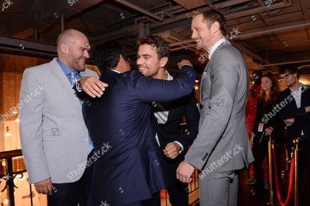 London UK 29th Sept 2016: Michael Pena, Director, John Michael Mcdonagh and Alexander Skarsgard Greet Co-star Theo James at the Picturehouse Central Leg of the War On Everyone 'premiere Crawl' Across London UK at Ritzy Picturehouse, Picturehouse Central and Finally Hackney Picturehouse On the 29th September 2016