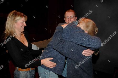 Stock Picture of 1st Night of Nightingale Written & Directed by Lynne Redgrave at the New End Theatre Hampstead London One Woman Cast Caroline John (r) is Hugged by Vennesa Redgraves Son Carlo Sparanero Watched by Corin Redgrave and His Daughter Gemma