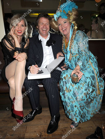 Book Launch Party For 'Private Collection' at Hix Oyster & Chiop House Cowcross Street Smithfield London For Danny Moynihan's Collection of Erotic Photography Danny Moynihan with 'Friends' Strippers Hired For the Party and His Wife Katrina Boorman ( in Blue)