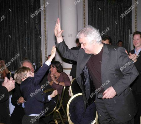 First Night Party For 'Whistle Down the Wind' at the Langham Hilton Hotel Bill Kenwright Gives A High-five to Laurence Belcher