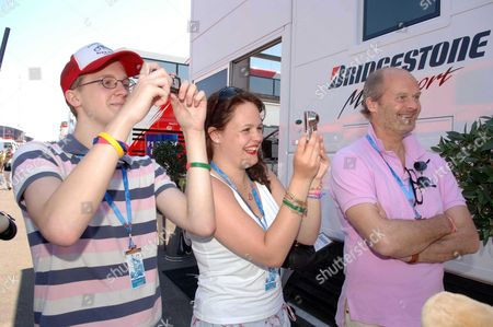 The British Grand Prix at Silverstone Qualifying Day the Hon Harry Fane with His Son & Daughter
