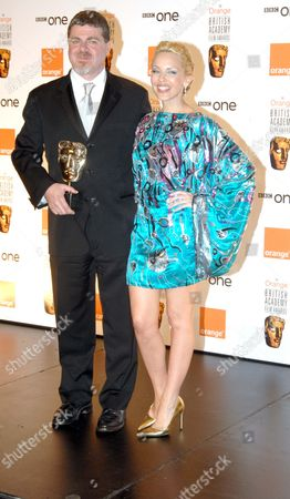 the 2007 Orange British Academy Film Awards Sponsored by Orange at the Royal Opera House Covent Garden Kylie Minogue Who Presented the Anthony Asquith Award For Achievment in Film Music to Gustavo Santaolalla For 'Babel'
