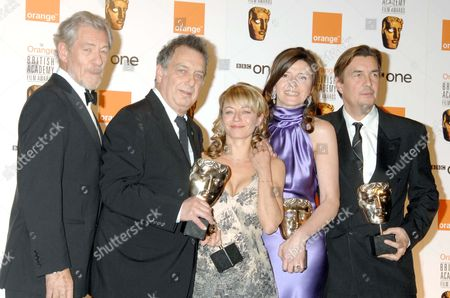 the 2007 Orange British Academy Film Awards Sponsored by Orange at the Royal Opera House Covent Garden Sir Ian Mckellen Who Presented the Award For Best Film For 'The Queen' to Stephen Frears Tracey Seaward Christine Langan and Andy Harries