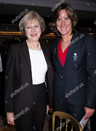 Stock Photo of London, United Kingdom, 17th October 2016: the Prime Minister Theresa May with Dr Katharine Grainger at the 61st Women of the Year Lunch and Awards at the Park Hotel in London On the 17th October 2016.