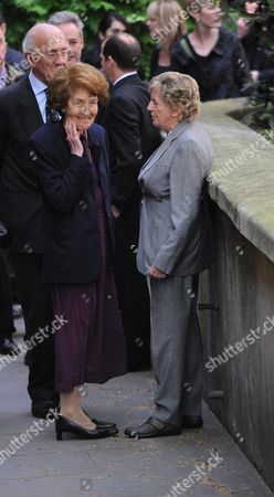 Arrivals at the Funeral For Sir Clement Freud at St Brides Fleet Street London Mrs Derek Nimmo & Lady Jill Freud