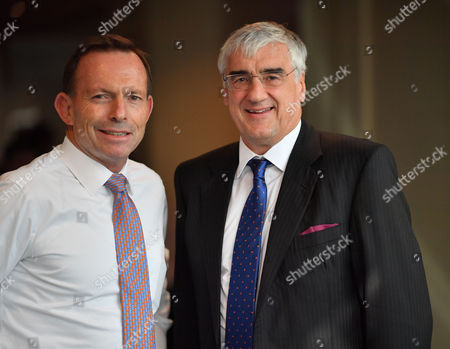 Birmingham, UK 3rd August 2016: Tony Abbott and Sir Michael Hintze at the Tory Party Conference in Birmingham, England On the 4th October 2016.
