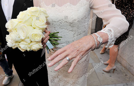 Wedding of Michael Winner to Geraldine Lynton-edwards at Chelsea Registry Office the Bride Shows Off Her Wedding Ring