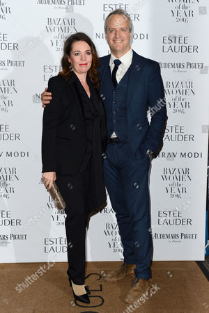 London, England 31st October 2016: Olivia Colman and Husband Ed Sinclair at the Harper's Bazaar Women of the Year Awards Held at Claridge's, Brook Street in London On the 31st October 2016.