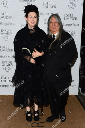 Stock Photo of London, England 31st October 2016: John Rocha and Odette Rocha at the Harper's Bazaar Women of the Year Awards Held at Claridge's, Brook Street in London On the 31st October 2016.