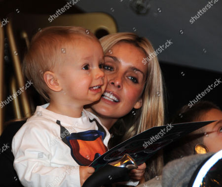 Stock Image of X Factor Semi Finalist Danyl Johnson Leads A Christmas Sing A Long in Selfridges in Aid of Mother4children in Widow Twankeys Cafe Lower Ground Floor Selfridges Oxford Street London Louise Redknapp Sings Along with Her Son Beau Henry Redknapp