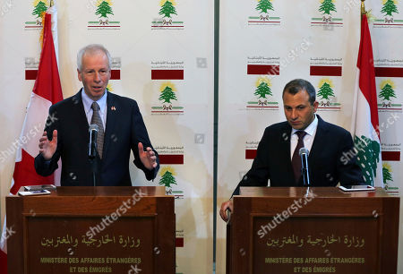 Gibran Bassil, Stephane Dion Canadian Foreign Minister Stephane Dion, left, speaks during a joint press conference with his Lebanese counterpart Gibran Bassil, at the Lebanese foreign ministry, in Beirut, Lebanon, . Dion is in Beirut to meet with Lebanese officials