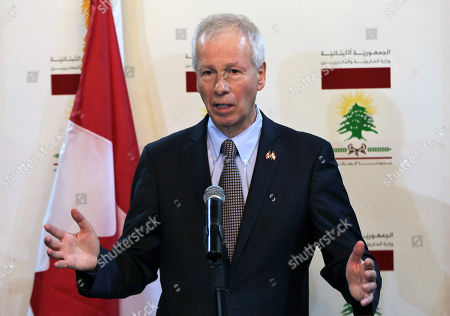 Canadian Foreign Minister Stephane Dion, speaks during a joint press conference with his Lebanese counterpart Gibran Bassil, at the Lebanese foreign ministry, in Beirut, Lebanon, . Dion is in Beirut to meet with Lebanese officials
